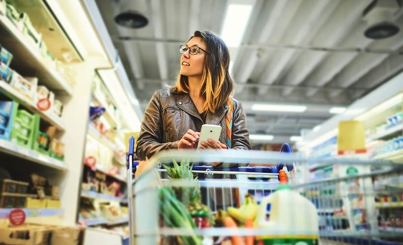 Grocery-STore-Lady-with-mobile